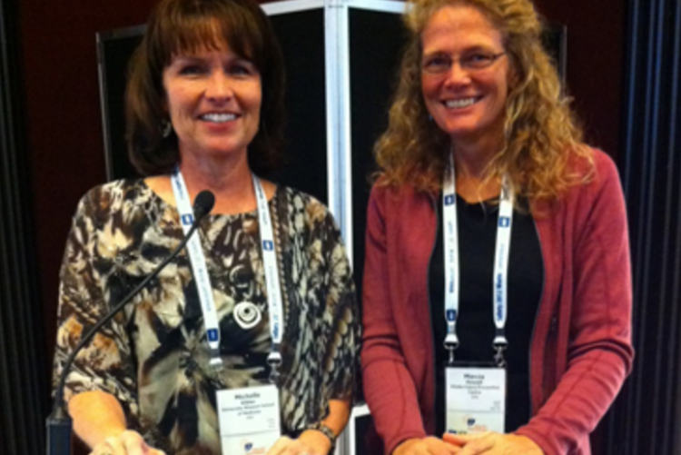 Marcia Howell (right), Director of International Safety Media Awards program, Alaska, pictured with Dr. Michelle Gibler (on left).